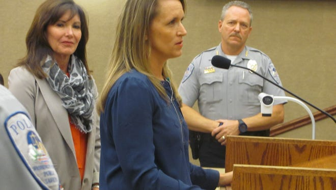 Intermountain Healthcare's Southwest Regional Manager of Community Benefit Amber Rich, center, addresses members of the Washington City Council as Intermountain's Operations Officer for Senior Services Jone Koford and Police Chief Jim Keith look on.