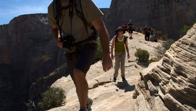 Hikers enjoy the trail to the top of Angels Landing in Zion National Park Thursday, April 21, 2016.
