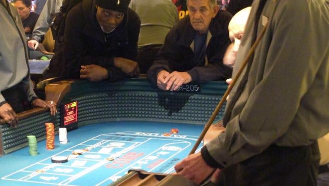 Gamblers play craps at the Tropicana casino in Atlantic City. Casino revenue increased in April.