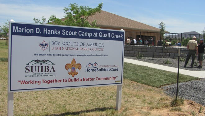 Boy Scouts of America officials and community members gather for the opening of the Marion D. Hanks Camp at Quail Creek during ribbon-cutting ceremonies Tuesday.