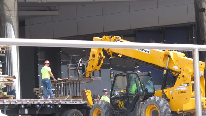 Workers deliver components of a rope-climbing course to the former Revel casino resort in Atlantic City Wednesday.