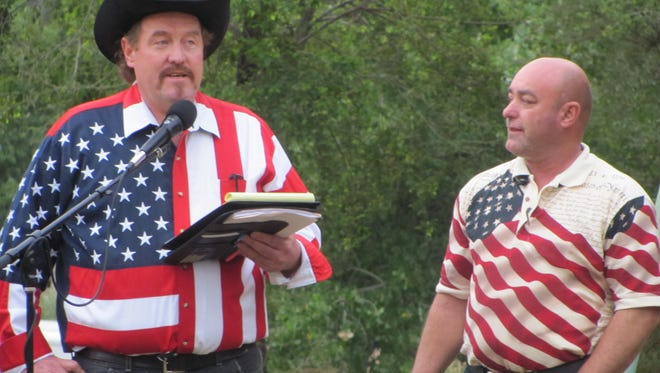 Harvey Dockstader Jr., left, and George Jessop address an early-morning crowd at Colorado City's Fourth of July holiday festivities on July 2. Dockstader is the acting president of the polygamous community's new Uzona Chamber of Commerce and is working to organize new economic development in the long-economically depressed desert region sandwiched between the Grand Canyon and Zion national parks.
