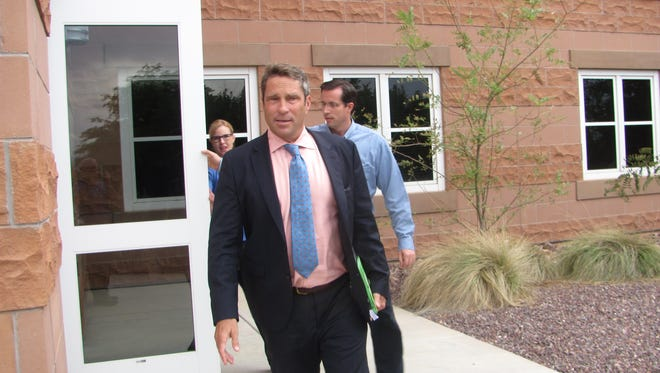 Defense attorney Scott Williams, followed by food stamp fraud defendant Preston Yates Barlow, leaves St. George's district courthouse Aug. 2 after a federal hearing on Barlow's detention. Barlow was freed from custody after the government dropped its claim he had violated the terms of an agreement letting him stay out of custody while he awaits trial on charges of conspiracy to defraud the federal government.