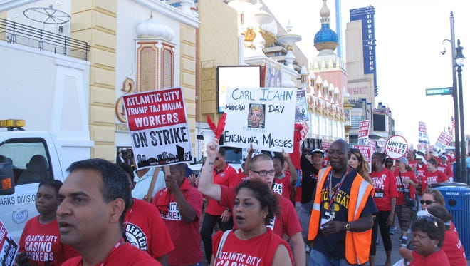 Union members picket  outside the Trump Taj Mahal casino in Atlantic City in July. The announcement this week that the Taj Mahal will close after Labor Day could bolster the arguments of both sides in a November referendum in which New Jersey voters will decide whether to authorize two new casinos in the northern part of the state near New York City.