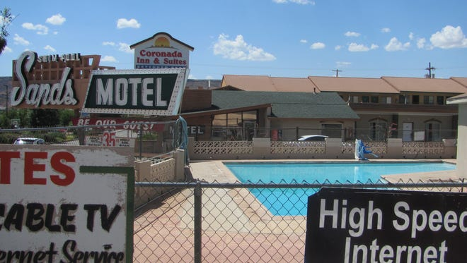 The enclosure for the Sands Motel swimming pool is shown Thursday in St. George. A 7-year-old boy found early Monday morning in the pool has died in an apparent drowning incident.
