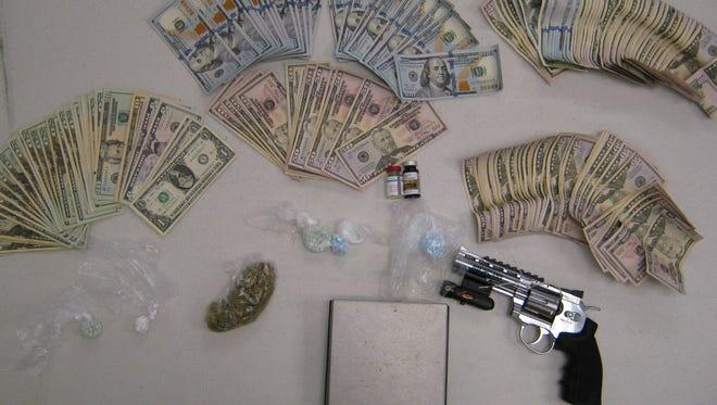 Hundreds of pills, drug paraphernalia, money and a pellet gun were seized during two separate drug raids by the Sandusky County Drug Task Force.