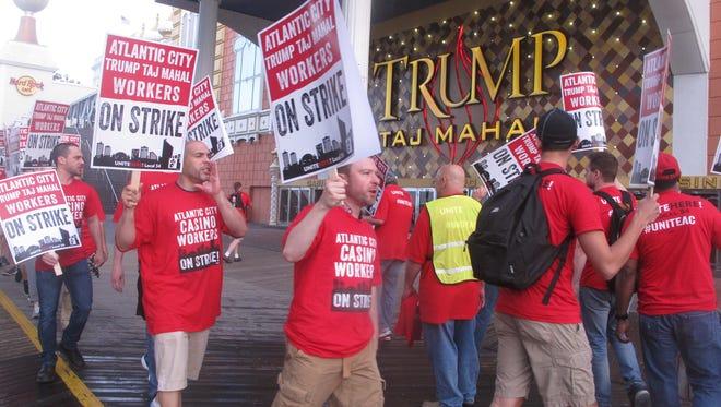 Striking union members demonstrate July 1 outside the Trump Taj Mahal casino in Atlantic City.