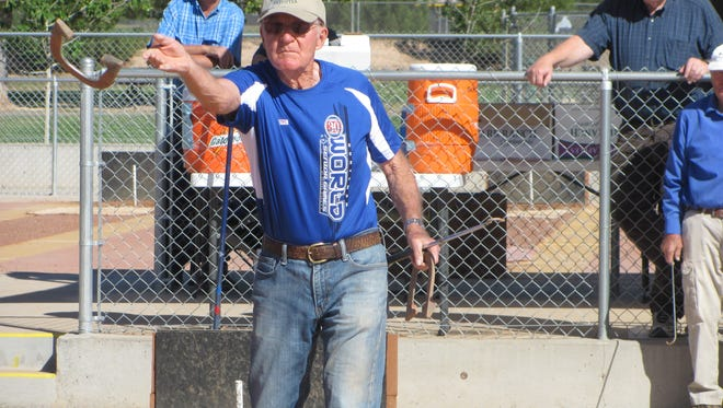 St. George resident Marvin Woodbury pitches a horseshoe Thursday during the annual Huntsman World Senior Games in St. George. Woodbury is among a select group of competitors who have participated in all 30 years of the Games, and remains active at 90.