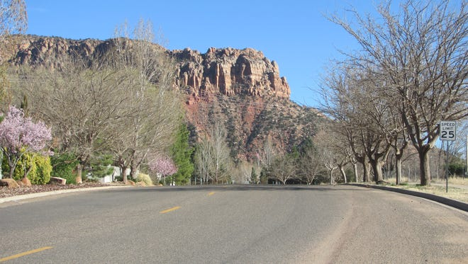 Vermillion-colored cliffs rise above Hildale Street in Colorado City
