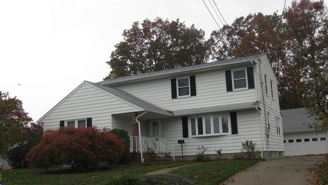 With six bedrooms and a large yard, this home offers a large family plenty of space.