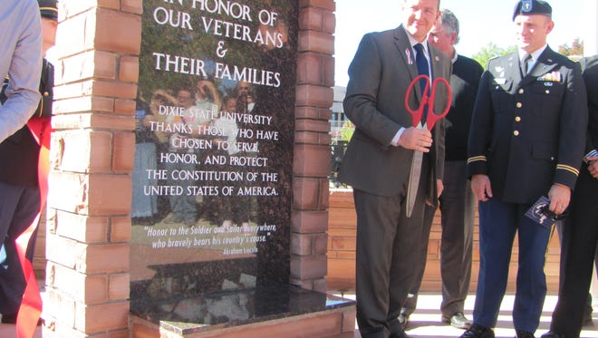 """Dixie State University President Richard """"Biff"""" Williams observes the crowd response after cutting the ribbon to unveil DSU's new Veterans Memorial on Friday."""
