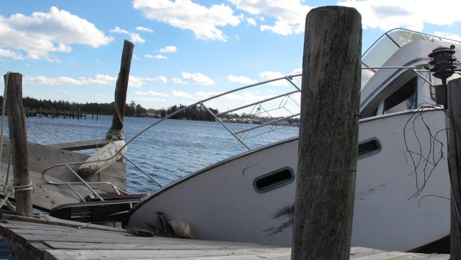 A dock in Toms River was damaged by a boat that slammed into it during Superstorm Sandy in 2012.