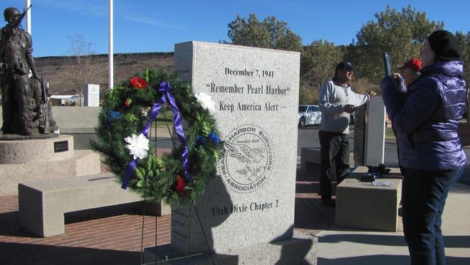 Participants in Wednesday's Pearl Harbor Day tribute in St. George visit the monument to the attack's veterans in the Tonaquint Cemetery. American Legion Post 90 conducted a brief ceremony at the memorial at 10:48 a.m. to coincide with the time of the attack 75 years ago.