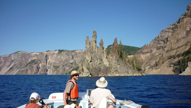 A park ranger gives a boat tour at Crater Lake State Park.
