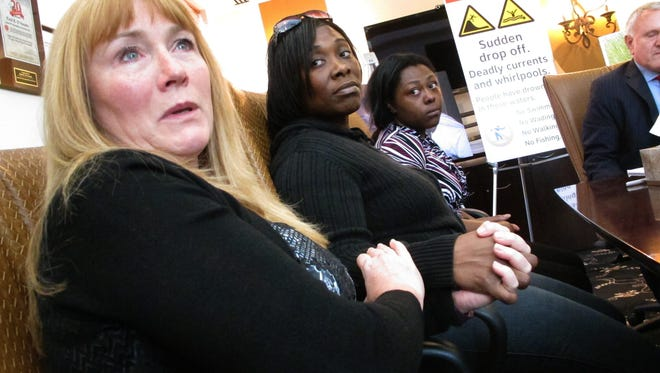 Sandra Smith, left, Tasha Hart, center, and Domonique McNeil, right, appear at a news conference in 2016 in Egg Harbor Township regarding the drowning deaths of relatives at a beach in North Wildwood.