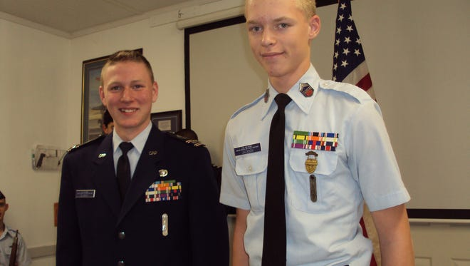 Bryce Jackson, right, spends his last day as a cadet non-commissioned officer, before promotion to second lieutenant.  At left is Josiah Bilbrey, Cadet Corps Commander.
