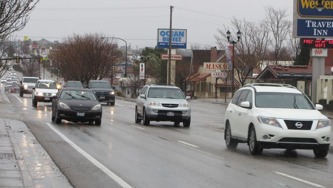 Drivers travel a rainy downtown St. George Boulevard on Friday.