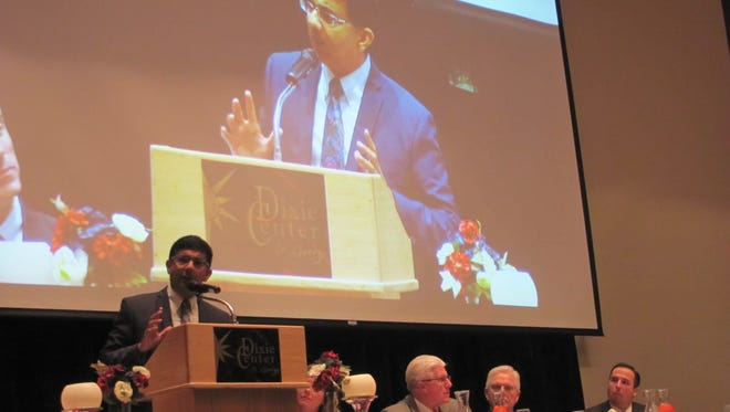 Nationally renowned author, filmmaker and political commentator Dinesh D'Souza talks about ideological divides over the recent presidential election Saturday during the Washington County Republican Party's Lincoln dinner at the Dixie Center in St. George.
