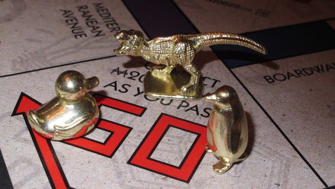 The three new tokens for Monopoly that fans from around the world have voted into upcoming editions of the board game: a duck, a T-Rex dinosaur and a penguin.