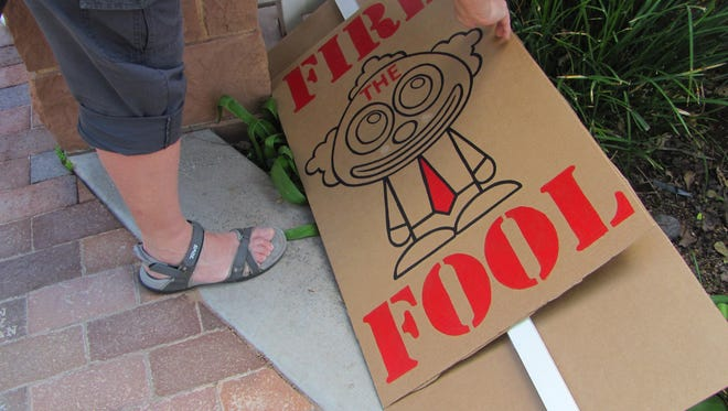 """A sign promoting the national """"Fire the Fools Day"""" movement at the St. George Town Square gazebo Saturday, April 1."""