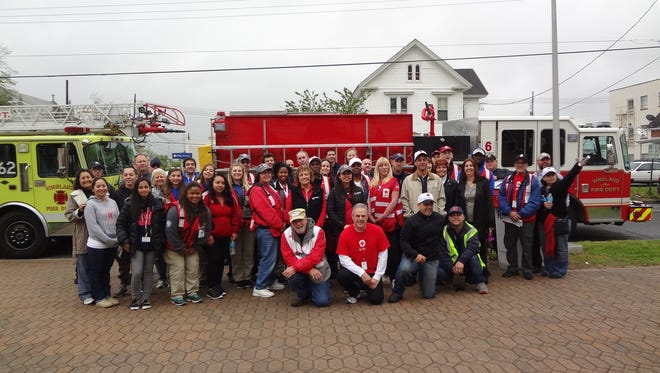 American Red Cross Home Fire Campaign brought together more than 45 volunteers, including many from the Vineland Fire Department, AmeriCorps teens, Vineland City Council, Cumberland County Freeholders and the American Red Cross, on April 22. The volunteers gathered at Vineland City Hall and then dispersed to canvas high risk communities in teams. They provided fire safety information and installed 268 free smoke alarms in homes that needed them.