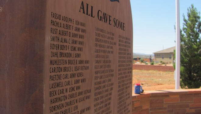 A stone slab at the new Santa Clara Veterans Memorial displays the names of city residents who have served in the nation's armed forces. A ribbon cutting for the memorial is scheduled May 25.