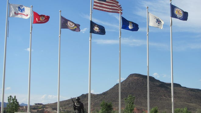 The American flag waves over the banners of the various military services at St. George's Tonaquint Cemetery in 2017.