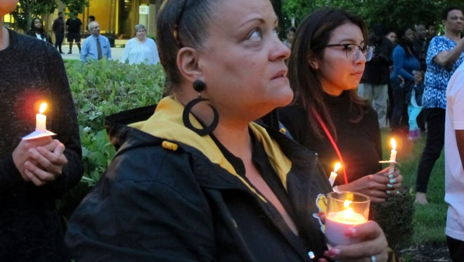 Hundreds attend a candlelight vigil for Richard Collins III at Bowie State University on Monday, May 22, 2017 in Bowie, Md. Collins, a student at the historically black university, was stabbed while visiting the University of Maryland, College Park. Sean Urbanski, a white student, has been charged with murder in Collins' death. (AP Photo/Brian Witte)