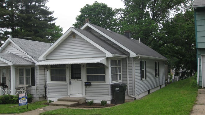 This ranch-style home in the Fords section of Woodbridge has two bedrooms, a kitchen with new appliances, a screened porch and a full basement.
