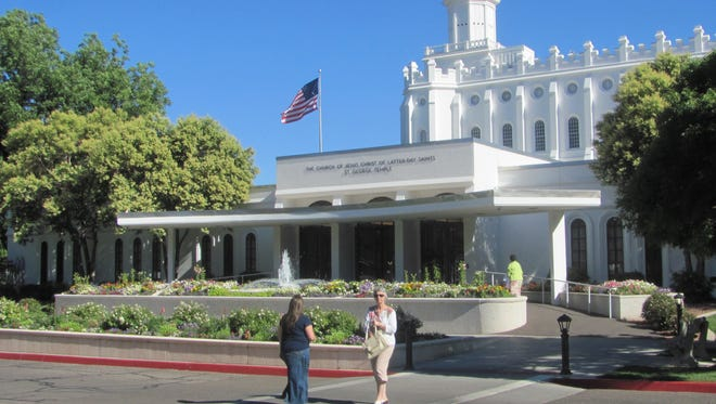 Members of The Church of Jesus Christ of Latter-day Saints visit the church's St. George Temple on Friday. Despite widespread rumors the temple might shut down for renovation once the faith's Cedar City Temple opens in October, church leaders say no such plans exist at this time.