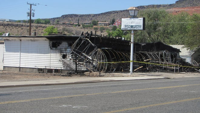 The burned remains of the old Wilkinson's House of Lighting electrical business on Tabernacle Street are shown Thursday, June 6, 2017.