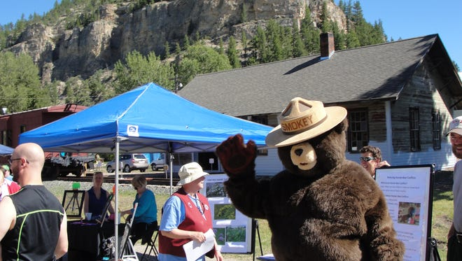 Smokey the Bear waves from the Monarch Rocks! Festival last year. This year's event takes place Saturday.
