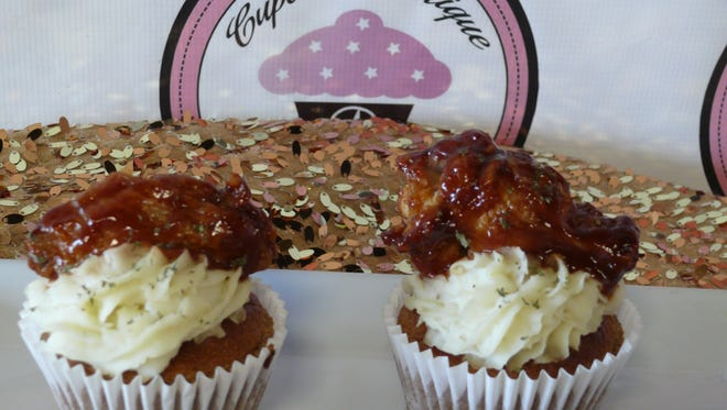 The Manatizer at DA Cupcake Boutique in West Melbourne is a savory cupcake made with cornbread with mashed potatoes and a chicken wing or a rib on top.