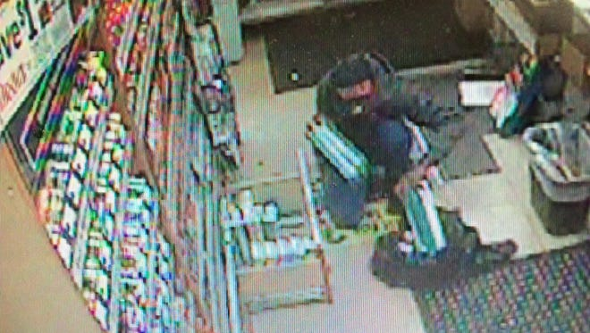 Authorities are looking for two men who allegedly stole 33 cigarette cartons from a Lee County gas station this week.