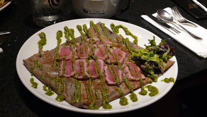 Wild Tuna crepe at Le Crave in Suntree features a generous amount of wild-caught, sushi-grade tuna, plus black pepper, brie cheese, asparagus, pesto basil sauce and lemon.