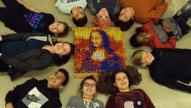 """Students crafted the """"Mona Lisa"""" from 100 Rubik's Cubes at Theisen Middle School. Pictured are  George Butler, Landiran Kern, Andrew Cortes, Chase Rast, Leo Lara, Raine Ferrer, Henry Tranel, Camille Emmerich, Riley Kutzik and Morgan McCourt."""
