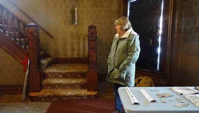 """The Harding Home sits empty as crews get to work restoring the home to its appearance in 1920, when Warren G. Harding was campaigning for the presidency. Harding Home Site Manager Sherry Hall says the wallpaper in the front entryway is far too dark and """"busy"""" to be of the 1920s era."""