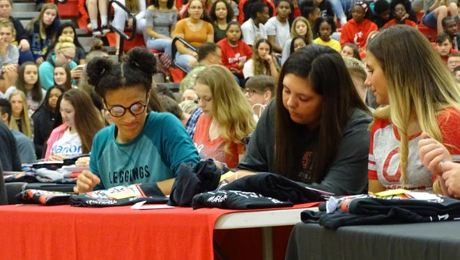 Arisdamel Diaz, left, and Allison Barr, center right, are bound for The Ohio State University. The Marion Harding High School seniors committed themselves to the university at the fourth annual Prezy Signing Day to celebrate seniors' plans after graduation.