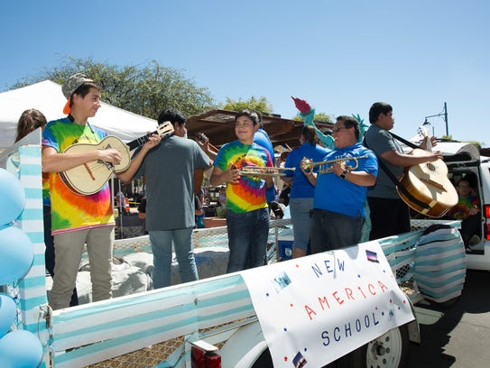 New America School rides a float playing mariachi music