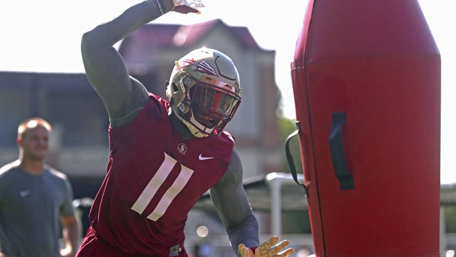 FSU's Janarius Robinson works out during their opening practice for fall camp at the Al Dunlap Training Facility Monday, Aug. 6, 2018.