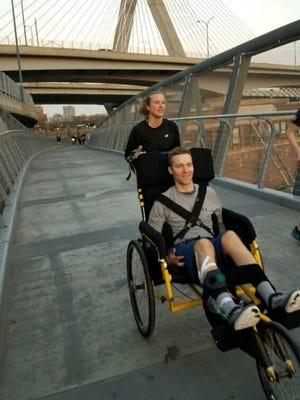Kaitlyn Kiely pushing Matt Wetherbee as they train to run the Boston Marathon route.