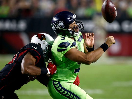 Seahawks quarterback Russell Wilson loses the ball out of bounds as he is hit by Cardinals inside linebacker Haason Reddick on Thursday in Glendale, Arizona.