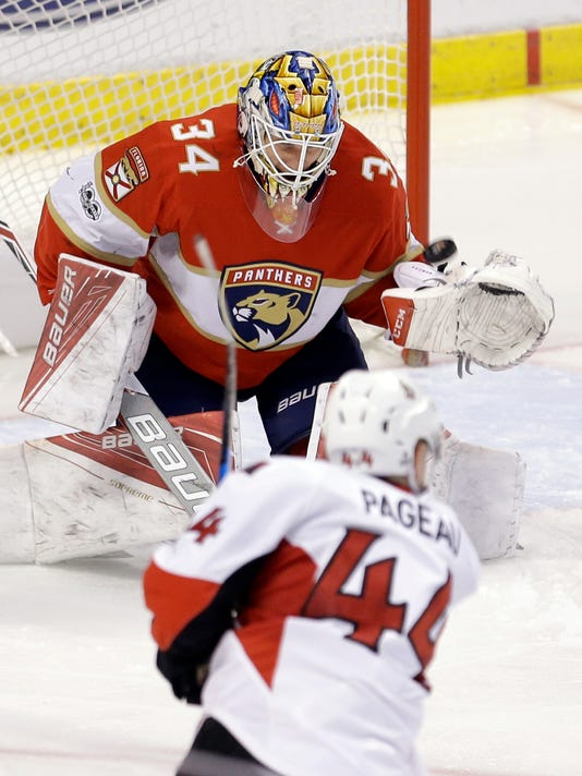 Florida Panthers goalie James Reimer (34) stops a shot by Ottawa Senators center Jean-Gabriel Pageau (44) in the second period of an NHL hockey game, Sunday, Feb. 26, 2017, in Sunrise, Fla. (AP Photo/Alan Diaz)