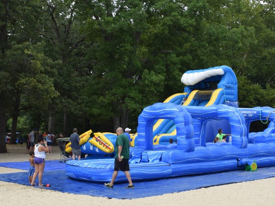 Inflatable water slides from American Bounce in Pittsgrove provided hours of entertainment for children during Christmas in July at Parvin State Park on Saturday, July 22. Photo/Jodi Streahle