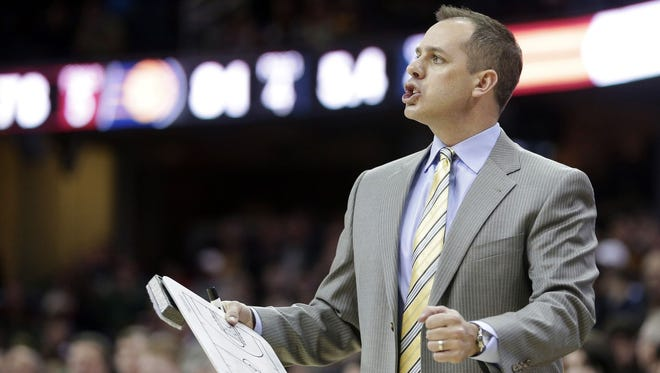 Indiana Pacers head coach Frank Vogel reacts in the fourth quarter of an NBA basketball game against the Cleveland Cavaliers, Sunday, Jan. 5, 2014, in Cleveland. The Pacers won 82-78.