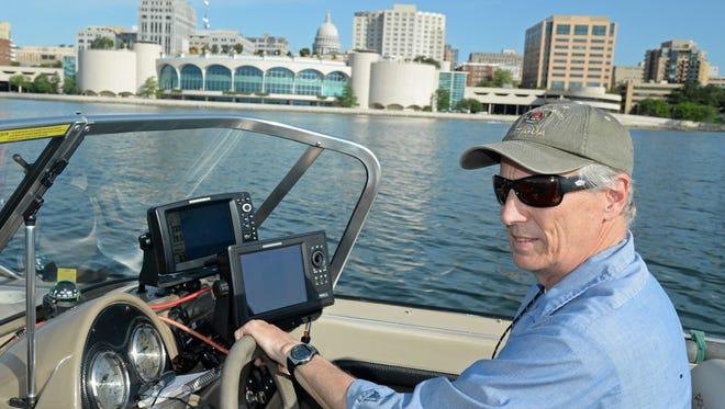 Rick Krueger uses a Humminbird side-sonar unit to reveal sunken secrets on Lake Monona near downtown Madison.