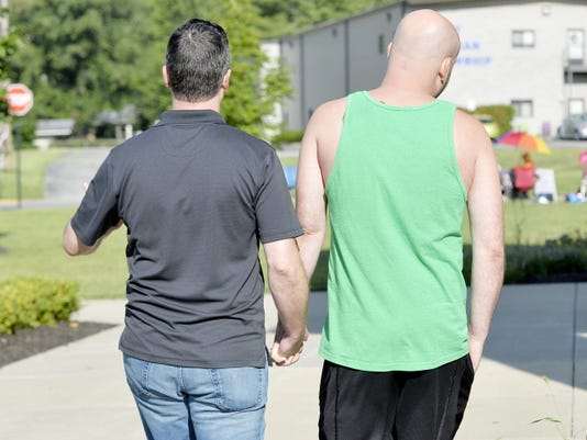 James Yates, left, and William Smith Jr. head into the Rowan County Courthouse to obtain a marriage license on Thursday in Morehead, Ky.