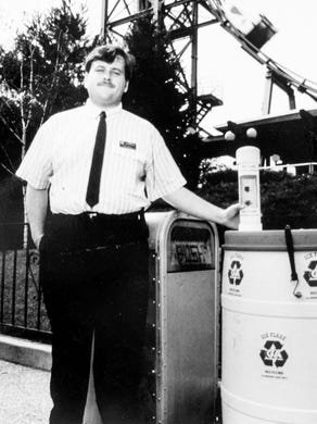 1990: Robert O'Neil stands with one of the recycling barrels at Great Adventure.
