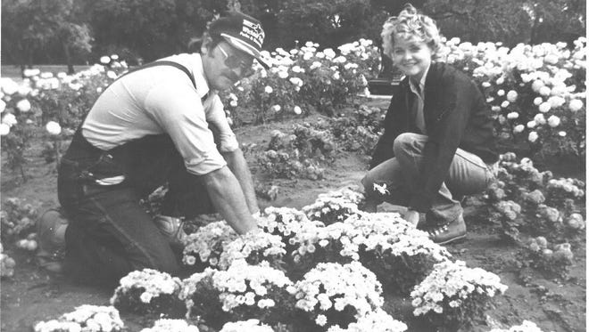 Larry Asmus, left, city horticultural staff, and Diana Stevens, horticulture supervisor, plant flowers in October 1987. Starting in the mid-1980s, under the leadership of Jack Murphy, the parks and recreation department gained honors for their beatification efforts for the city.
