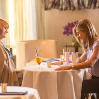 "This image released by Open Road Films shows Kate Hudson, left, and Sarah Chalke in a scene from ""Mother's Day."" (Ron Batzdorff /Open Road Films via AP)"